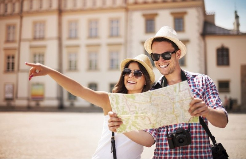 20676868 - happy tourist sightseeing city with map
