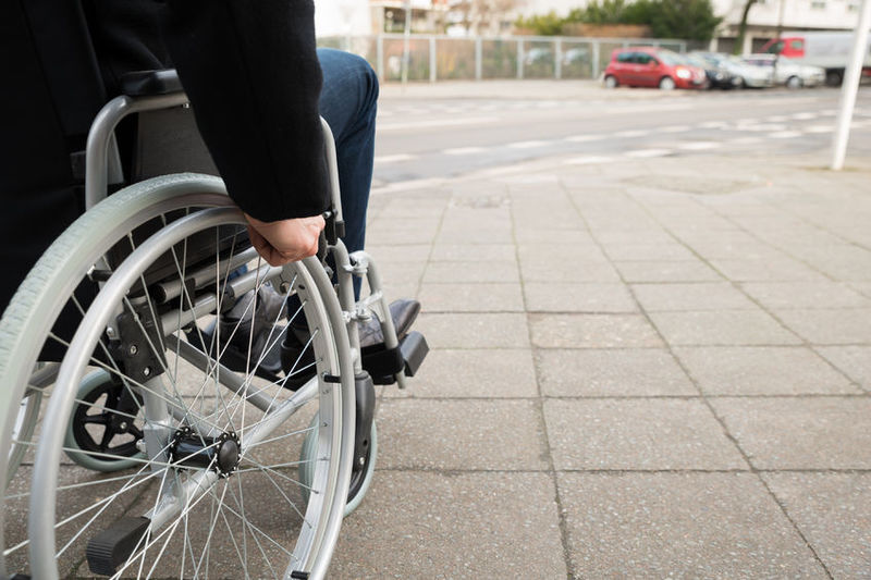 39943045 - close-up of disabled man sitting on wheelchair